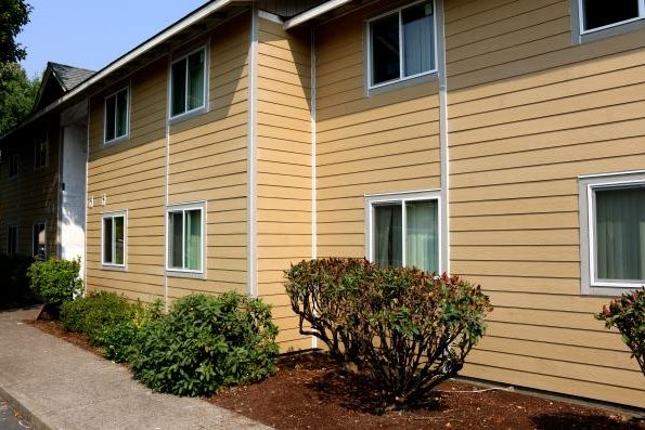 Apartments with new siding installed.