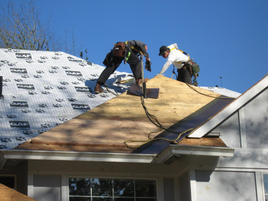 Roof repair in Seattle, Washington. SFW Construction LLC.