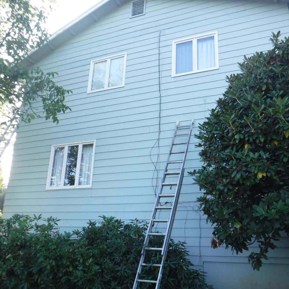 Siding Repair On Tall House