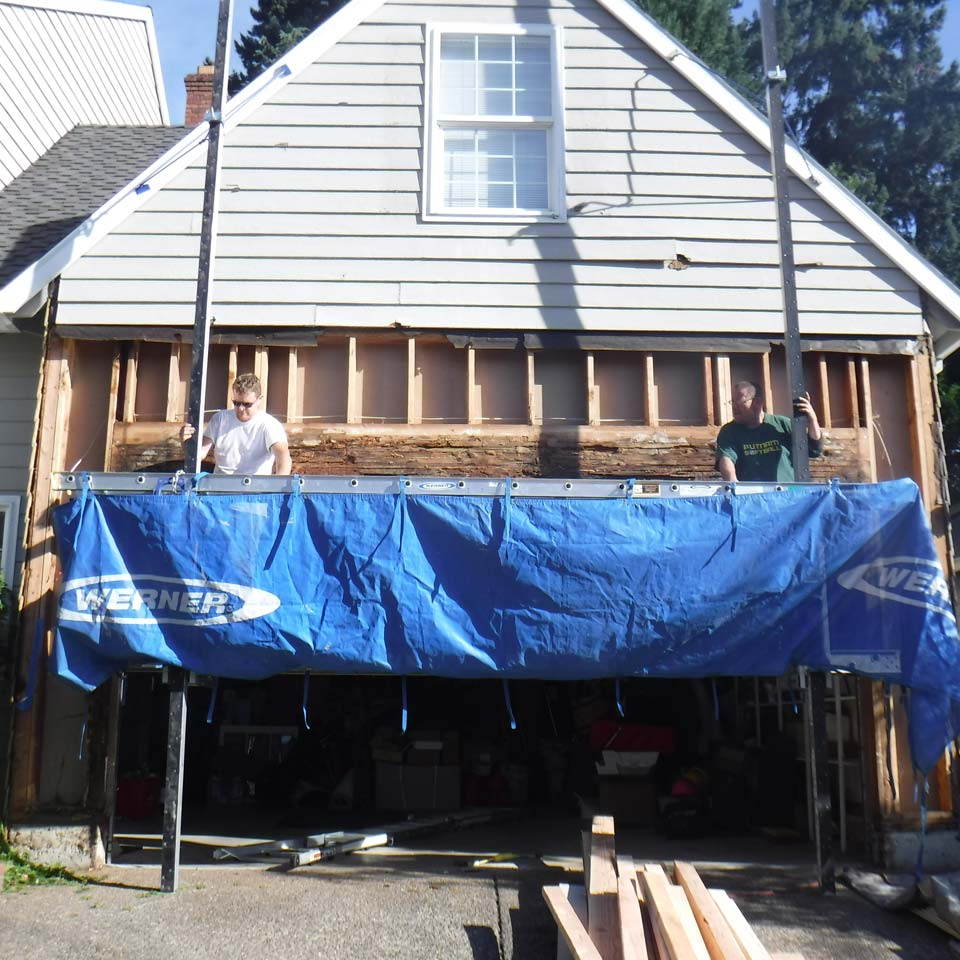Siding Repair Above Garage