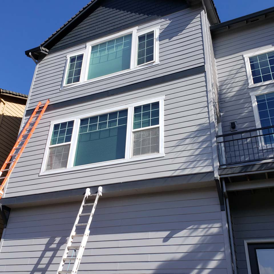 Siding Repair On Tall Home